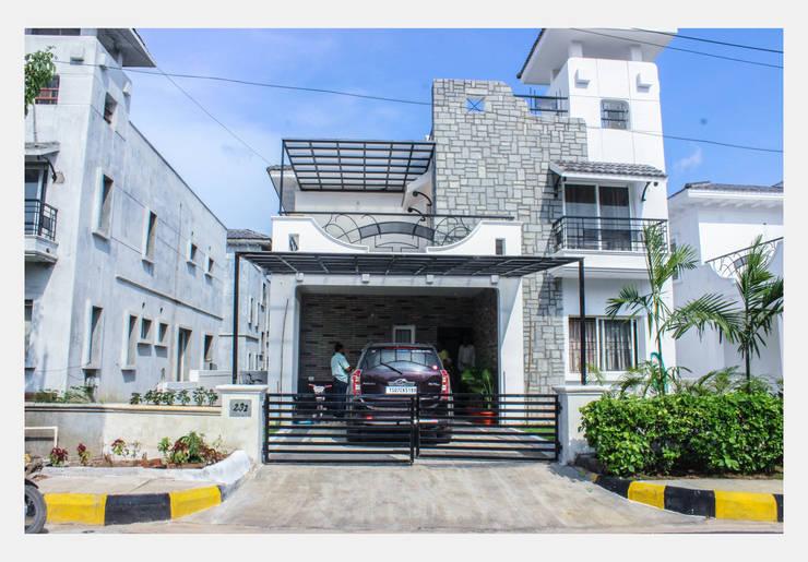 Villa at Appa Junction, Hyderabad.:  Walls & flooring by Happy Homes Designers