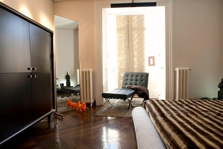 Projekty,  Sypialnia zaprojektowane przez MILLENIUM ARCHITECTURE