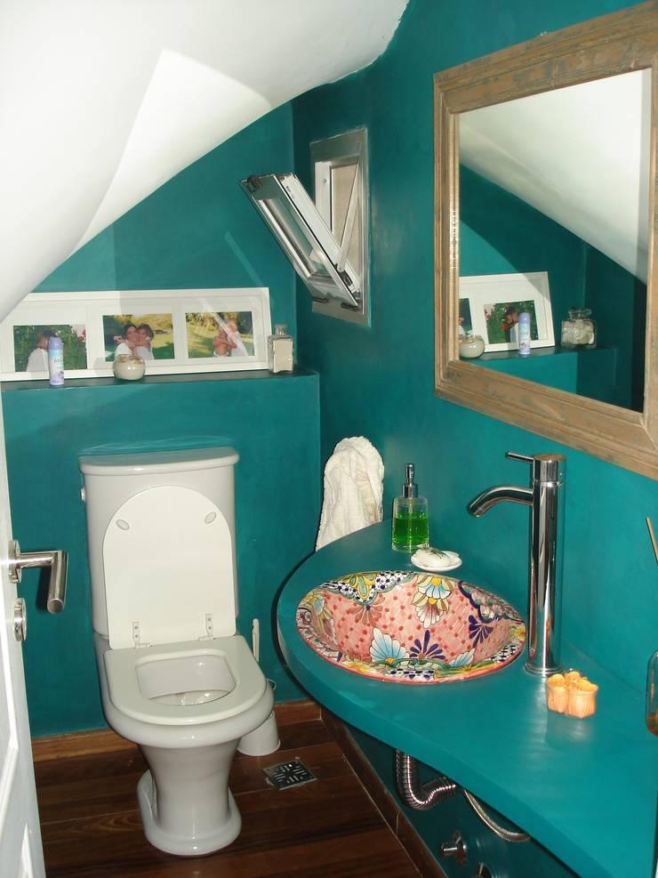 Toilette: Baños de estilo rústico por Fainzilber Arqts.