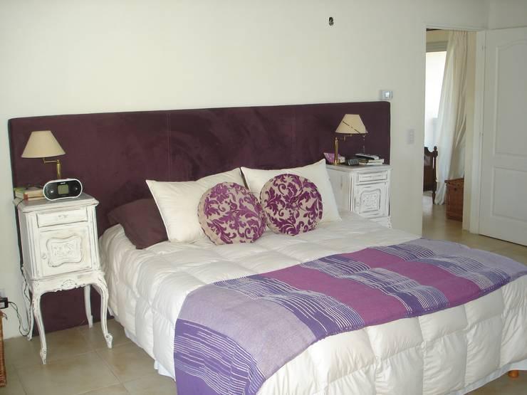 Dormitorios de estilo  por Fainzilber Arqts.