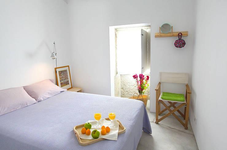 Dormitorios de estilo  por MANUEL CORREIA FERNANDES, ARQUITECTO E ASSOCIADOS
