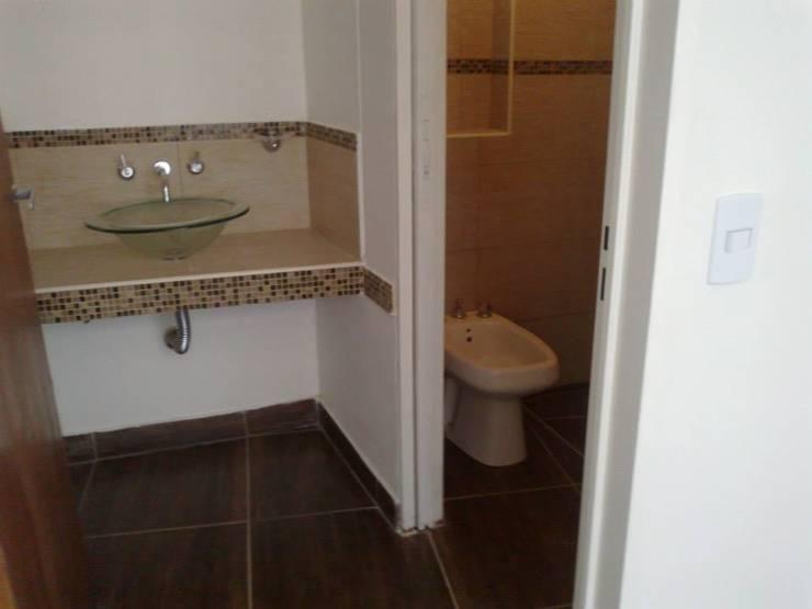 PROYECTO IBERA: Baños de estilo  por ESTUDIO PINKUS S.R.L.,Moderno
