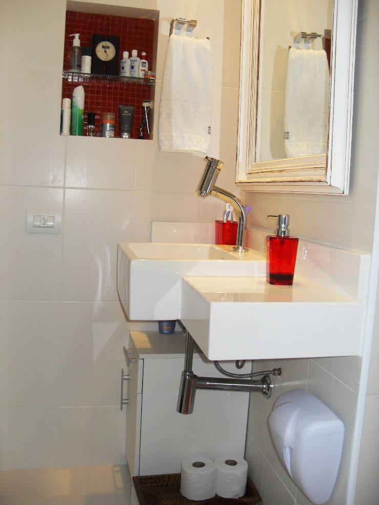Banheiro Suite: Banheiros  por Atelier Espaço Santa