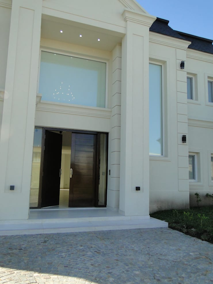 Casa en Castores – Nordelta: Casas de estilo  por Arquitectos Building M&CC - (Marcelo Rueda, Claudio Castiglia y Claudia Rueda),Clásico