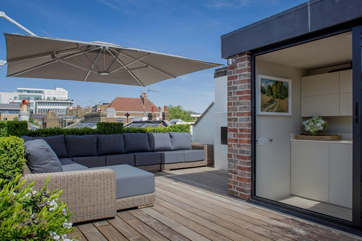 ​The roof terrace at the Chelsea House.:  Terrace by Nash Baker Architects Ltd
