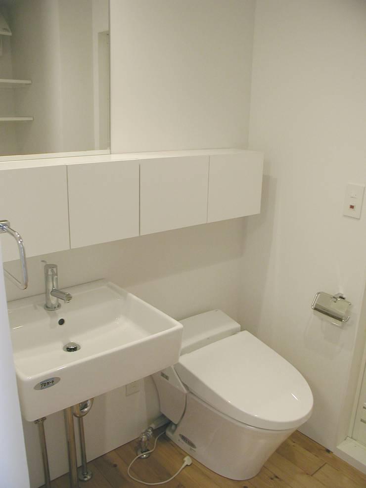 Bタイプ 水回り: Unico design一級建築士事務所が手掛けた浴室です。