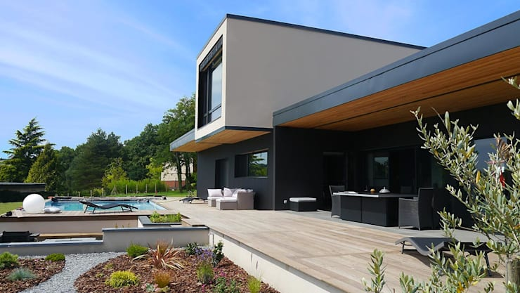 passé recomposé (Rhône): Maisons de style  par atacama architecture