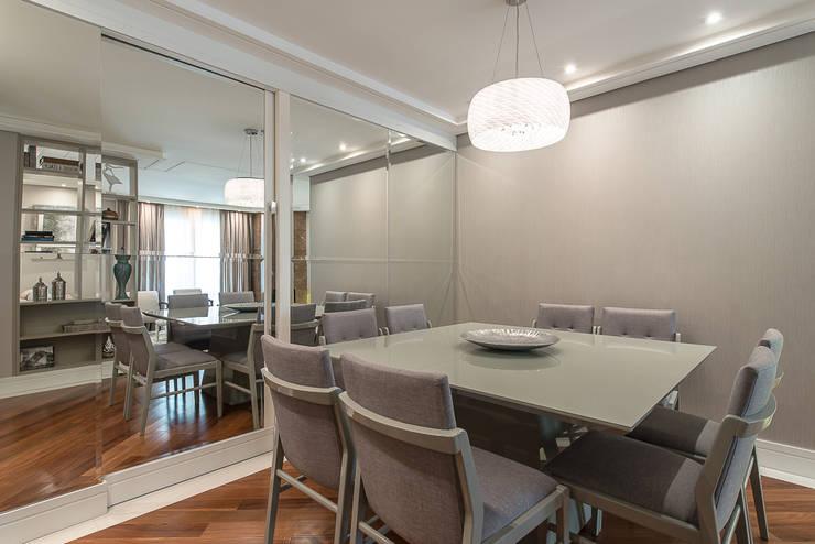 Apartamento B24: Salas de jantar  por Saad.Ribeiro Arquitetura e Interiores