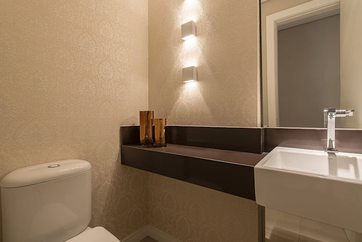 Apartamento B24: Banheiros  por Saad.Ribeiro Arquitetura e Interiores