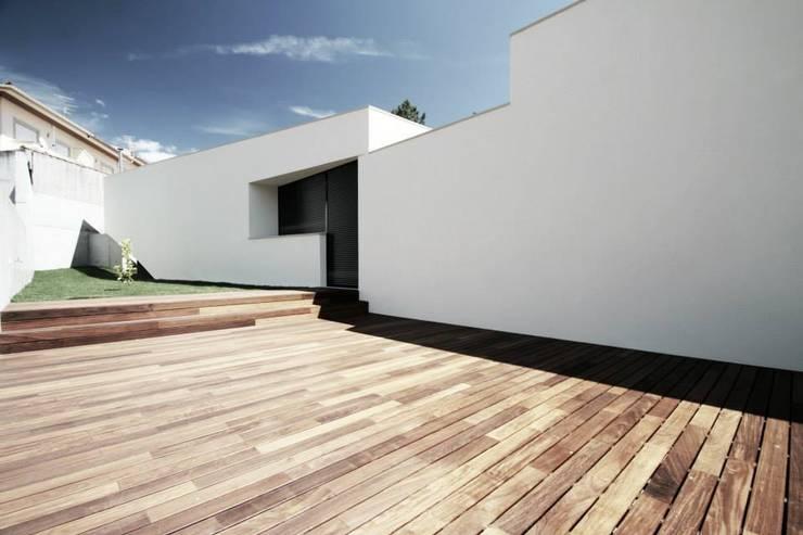 Casa Galegos: Casas modernas por TRAMA arquitetos