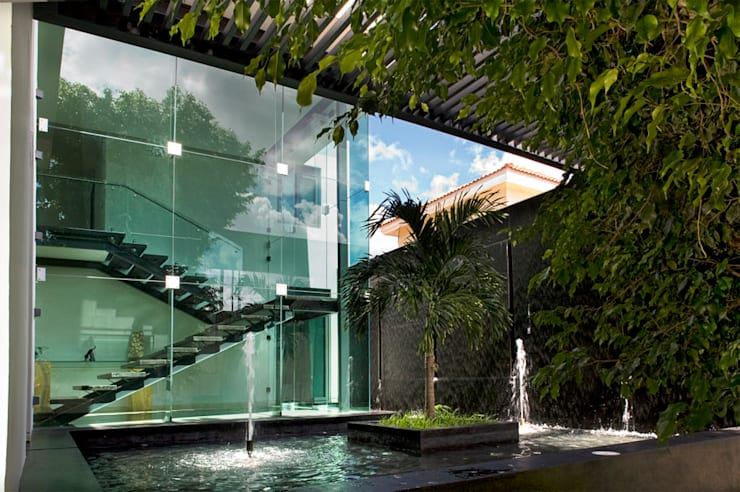 Residencia JC-ROA: Jardines de estilo  por AIDA TRACONIS ARQUITECTOS EN MERIDA YUCATAN MEXICO