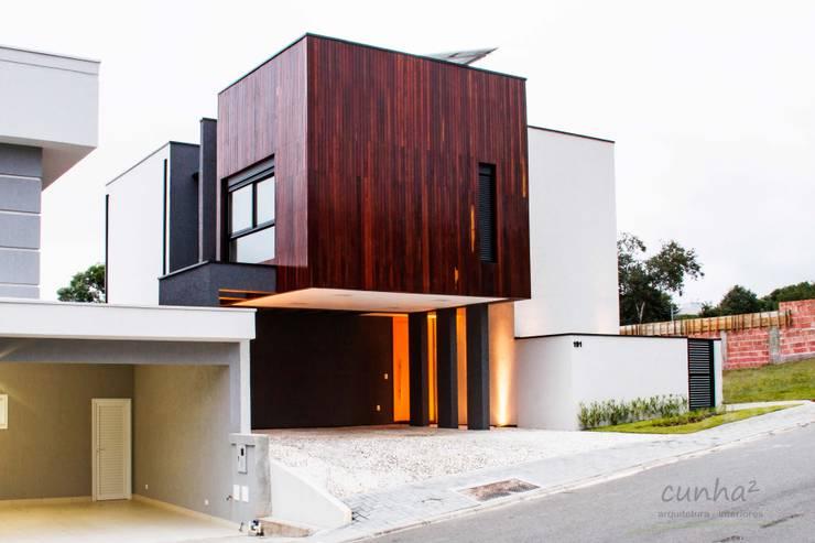 Projekty, minimalistyczne Domy zaprojektowane przez cunha² arquitetura