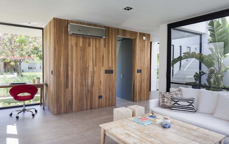 Salas de estar  por Estudio PKa. / Pessagno Kandus arquitectos