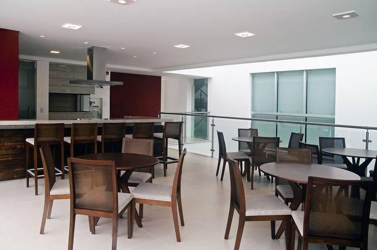 Confraria: Edifícios comerciais  por CMSP Arquitetura + Design