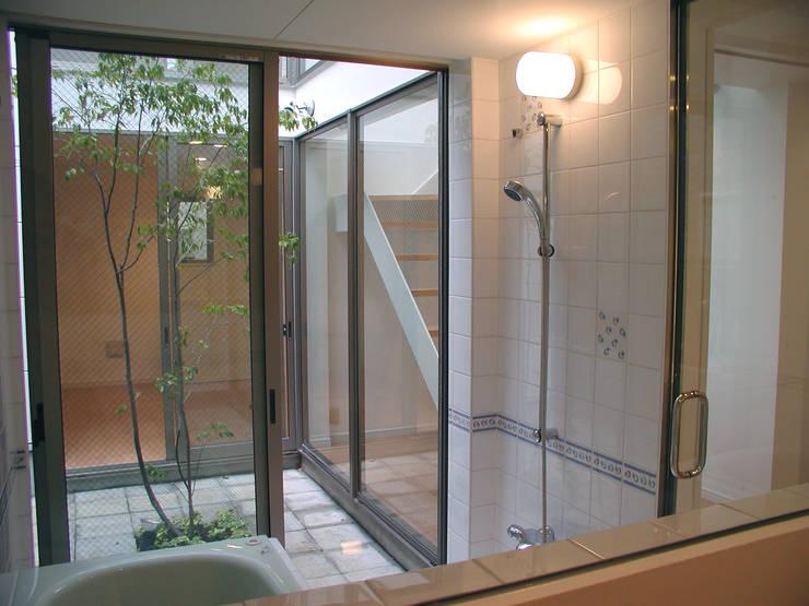 浴室: Unico design一級建築士事務所が手掛けた浴室です。