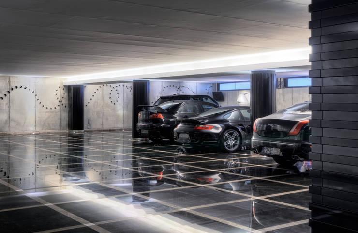 Timeless with a twist: Garagens e arrecadações  por Viterbo Interior design