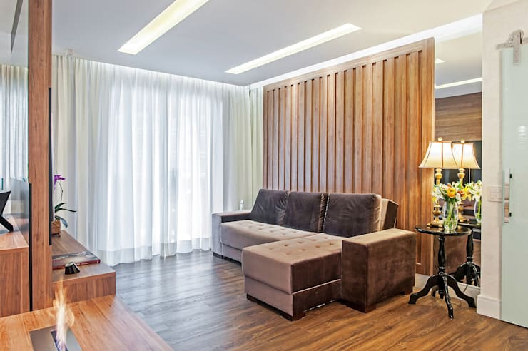 Apartamento 601: Salas multimídia  por Patrícia Azoni Arquitetura + Arte & Design