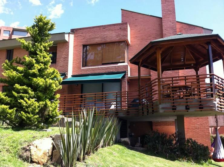 Maisons de style  par Vertice Oficina de Arquitectura, Minimaliste