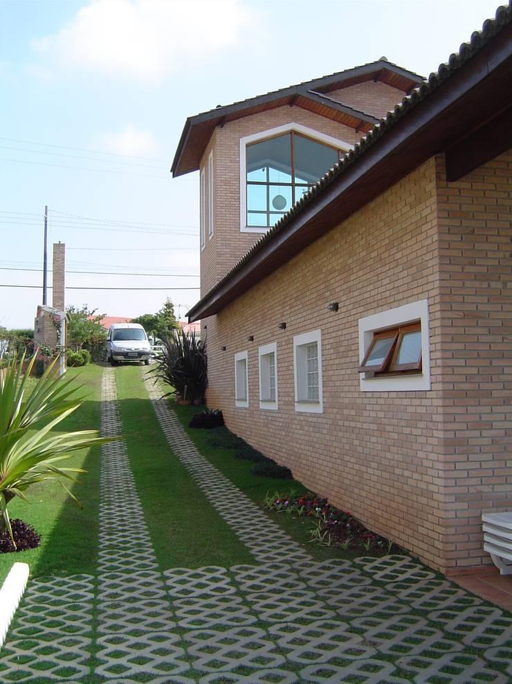 Casa de campo em São Roque: Casas  por GATE Arquitetos Associados
