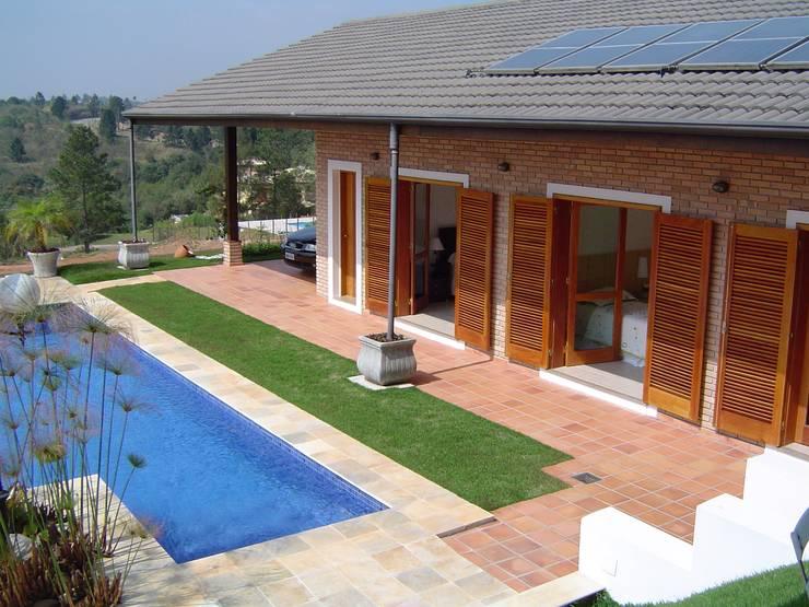 Casas de estilo rústico por GATE Arquitetos Associados