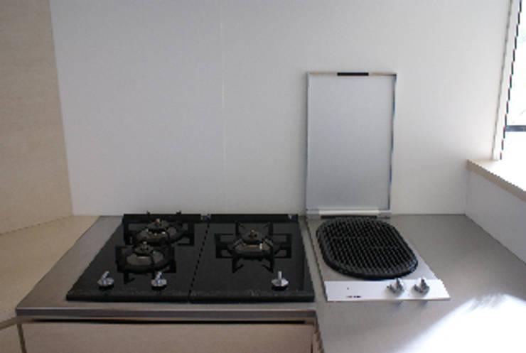 フレンチモロカンスタイルのリフォーム: WISHが手掛けたキッチンです。,モダン