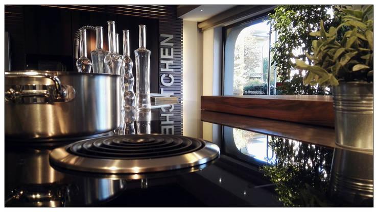 Piano Cottura Induzione con Cappa integrata: Bora mod. Basic: Cucina in stile  di Formarredo Due design 1967, Industrial