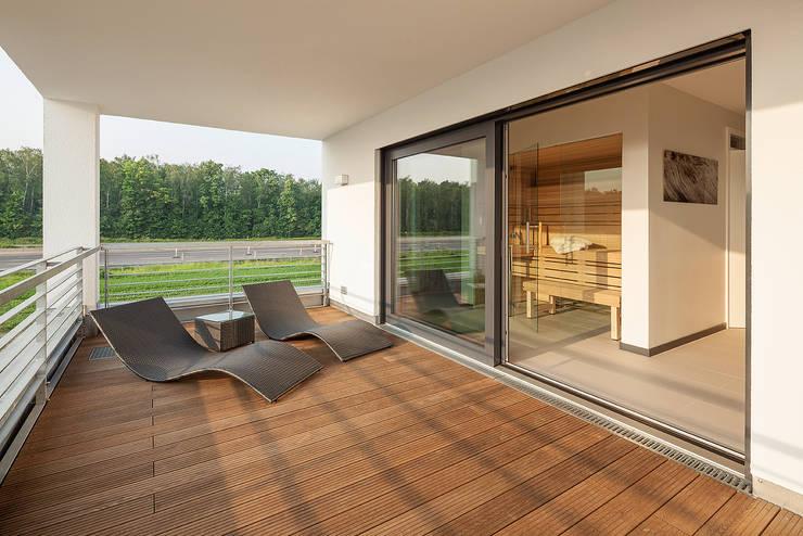Terrazas de estilo  por Lopez-Fotodesign
