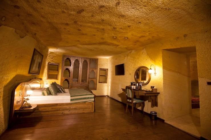 Kayakapi Premium Caves - Cappadocia – Muhittin Toker evi Öncesi ve Sonrası: rustik tarz tarz Yatak Odası