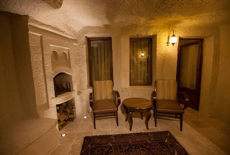 Kayakapi Premium Caves - Cappadocia – Kunduracı Mehmet evi Öncesi ve Sonrası:  tarz Oturma Odası