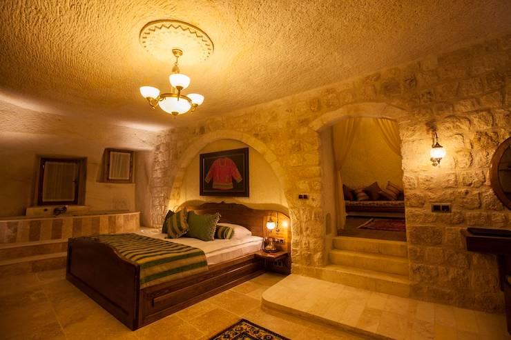 Kayakapi Premium Caves - Cappadocia – Kunduracı Mehmet evi Öncesi ve Sonrası:  tarz Yatak Odası