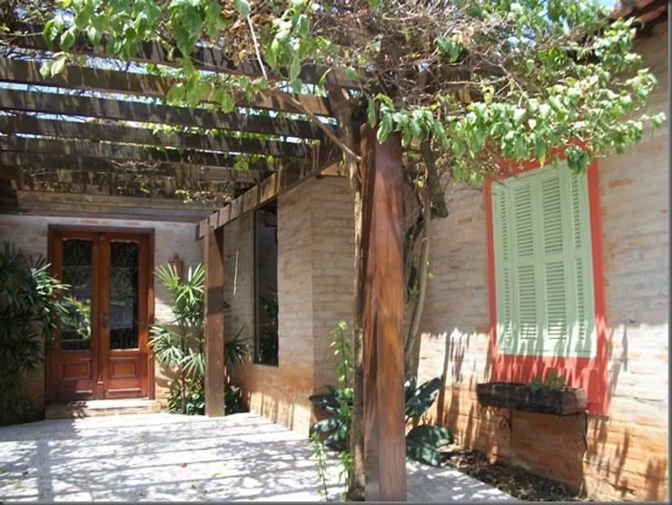 Casa Ferreira: Casas  por terrabentoprojeto