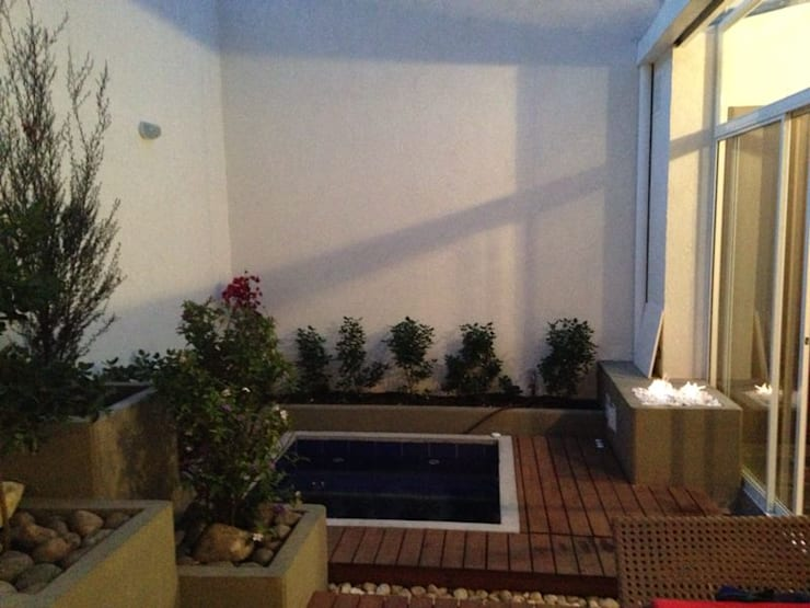 CASA SANCHEZ: Jardines de estilo moderno por unouno estudio
