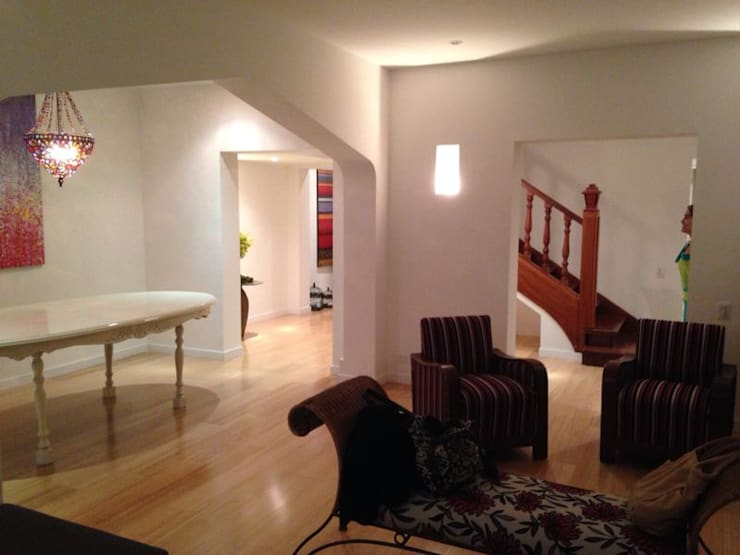 CASA SANCHEZ: Salas de estilo moderno por unouno estudio