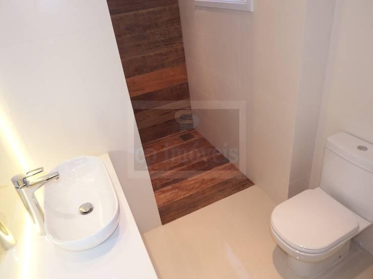 Casa J1: Casas de banho  por Cipriani Arquitetura e Construção