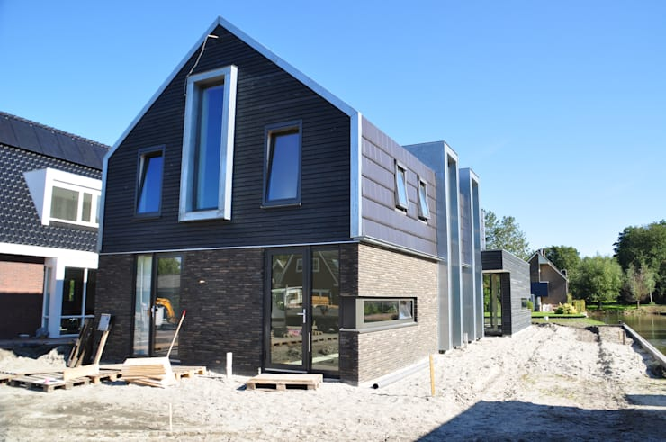 voorgevel:  Huizen door Nico Dekker Ontwerp & Bouwkunde, Modern Hout Hout