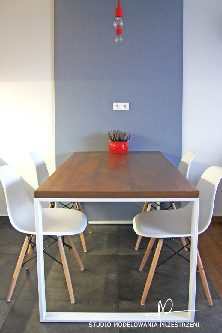 nowoczesne i przytulne mieszanie : styl , w kategorii Kuchnia zaprojektowany przez Studio Modelowania Przestrzeni