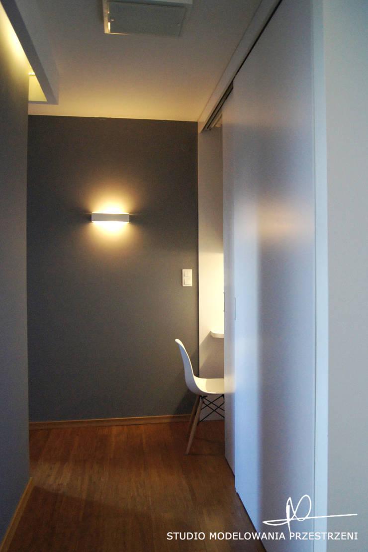 nowoczesne i przytulne mieszanie : styl , w kategorii Domowe biuro i gabinet zaprojektowany przez Studio Modelowania Przestrzeni