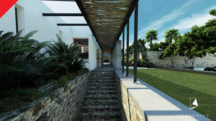 Casa de Campo Tempoal : Pasillos y recibidores de estilo  por Tectónico