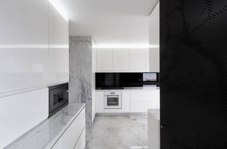 Apartamento Olivais: Cozinhas  por nmdarq