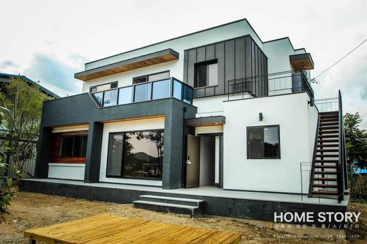 Casas de estilo moderno por (주)홈스토리