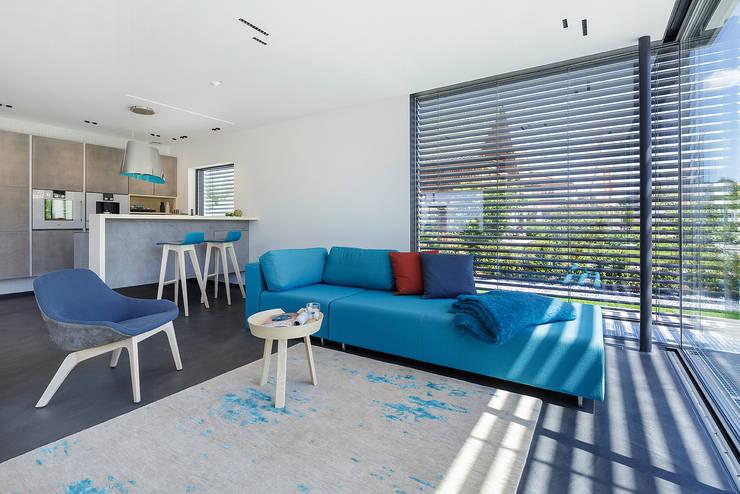Salones de estilo moderno de Lopez-Fotodesign