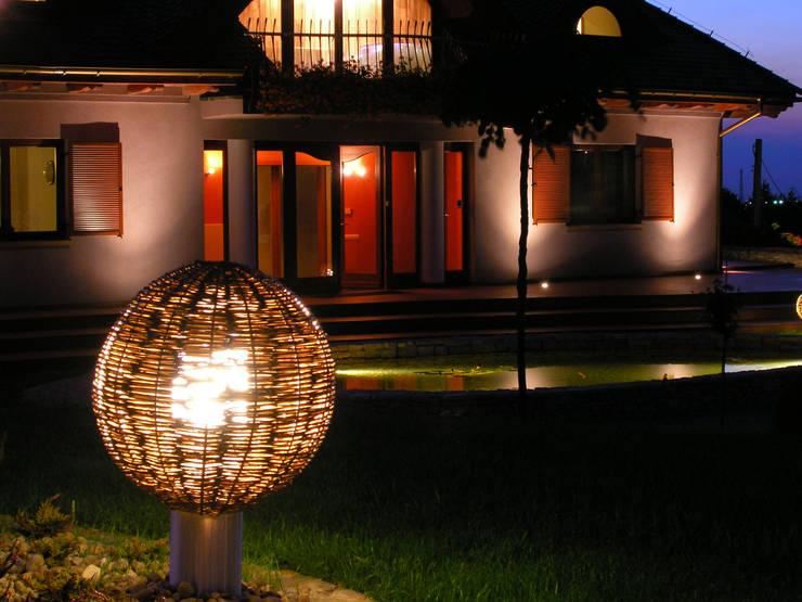 Ogród z altaną: styl , w kategorii Domy zaprojektowany przez Pracownia Projektowa Architektury Krajobrazu Januszówka