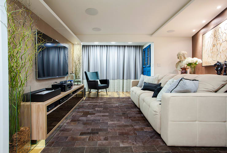 Salas de entretenimiento de estilo  por Estúdio HL - Arquitetura e Interiores