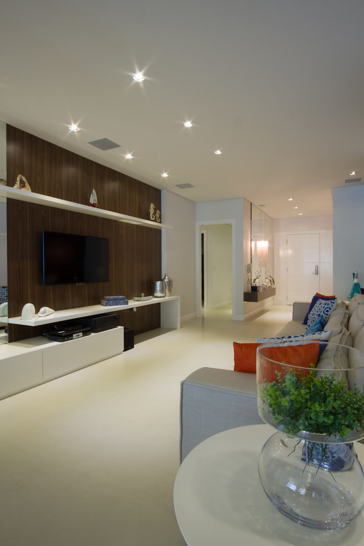 Apartamento de Veraneio : Salas de estar  por Sieli Haynosz / Arquitetura + Interiores
