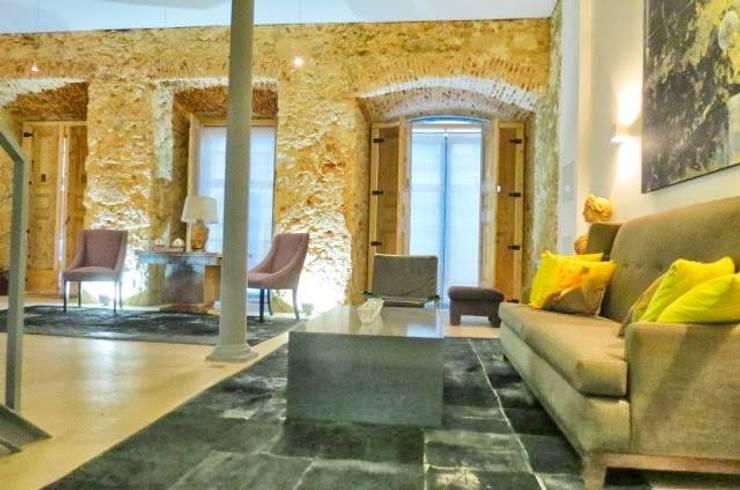 Loft Story: Salas de estar  por DRCF Arquitectos