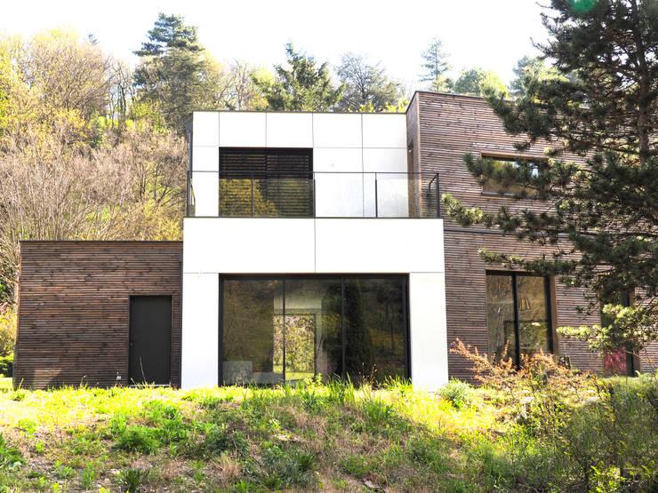 Parcel house: Maisons de style de style Moderne par archizip