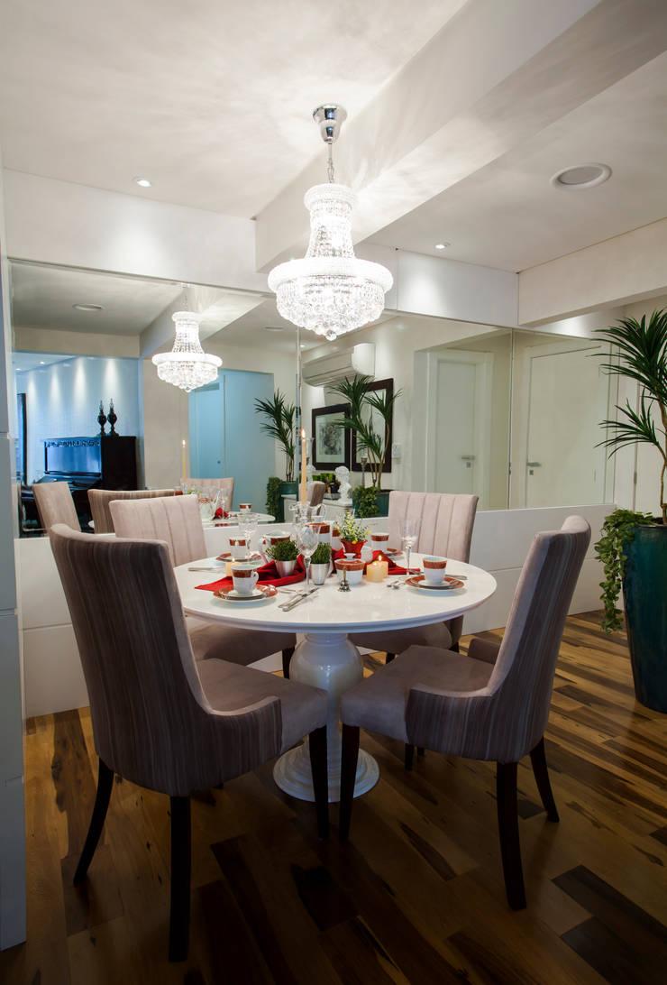 Sala de Jantar apto em BC: Salas de jantar  por Estúdio HL - Arquitetura e Interiores