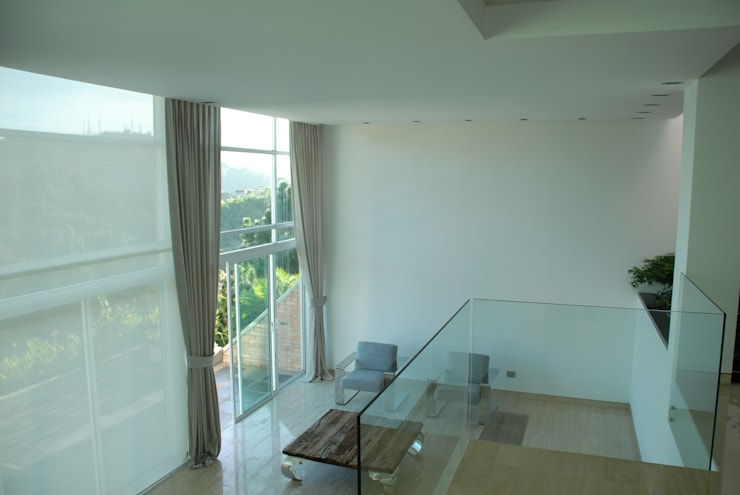 Casa el Hatillo: Salas / recibidores de estilo  por Arquitecto Juan Pablo Fernandes