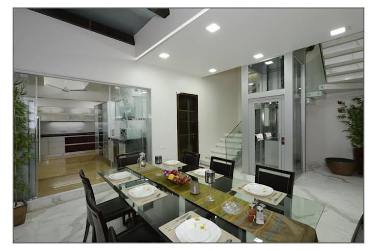 Bungalow project:  Dining room by CK Interiors Pvt Ltd