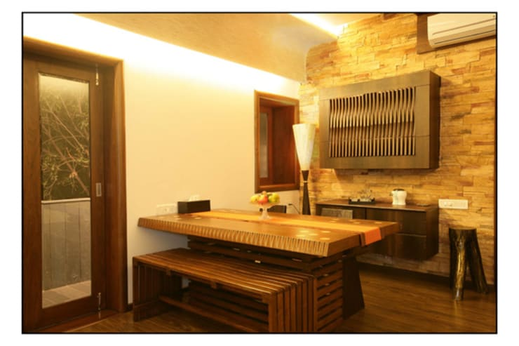 Konnur site:  Dining room by CK Interiors Pvt Ltd